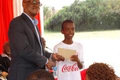 Coca-Cola Official awarding a student