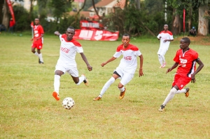 Olbollosat secondary school's, Ryan Sifuna (left) and Ibrahim Alio, chase for the ball, as Peter Mwangi, from Upper hill secondary school, maneuvers for an attack.