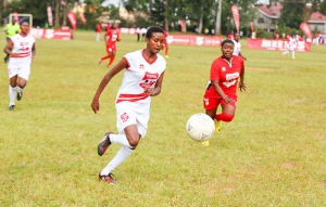 Rael Tepeina (in white), from Mua Girls, defends her ball possession as, Mwandoro Mwanajuma, from Waa Girls, attacks.
