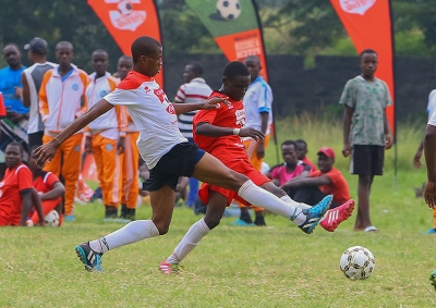 Allan Lukonzo of Goseta boys (L) fights for the ball with Seranis Sufii Mohammed in the the Copa Coca cola under boys 16 National Finals Tournament 2019 at Kisumu National Polytechnic Kisumu.