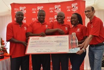 Receiving Ksh.15M Cheque form Coca Cola Company